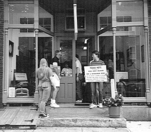 Moving Again! Bob & Paul Wakeman (holding sign)