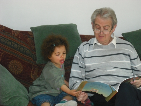 Barrie reading with his granddaughter Hannah